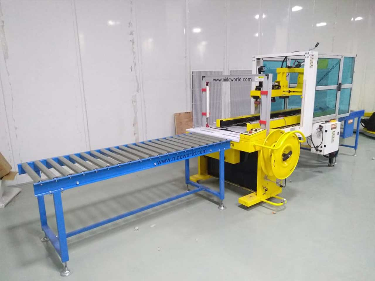 Semi auto flap folding carton sealer with auto strappingSemi Automatic Flap Folding & Carton Sealer with Auto Strapping