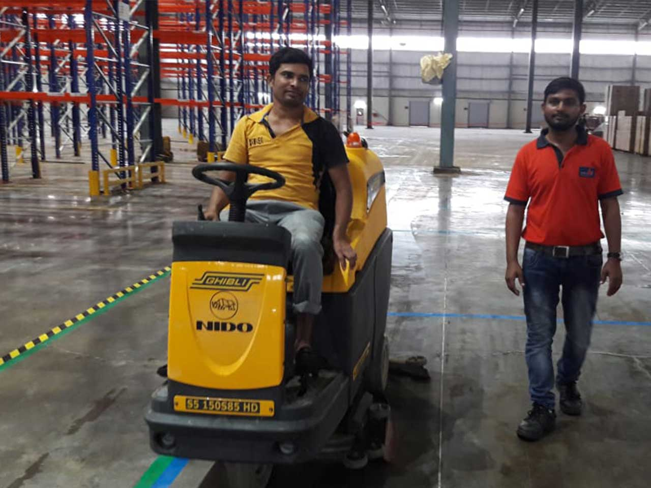 Ride On - Battery Sweeper with Collector- Industrial Cleaning at Warehouse
