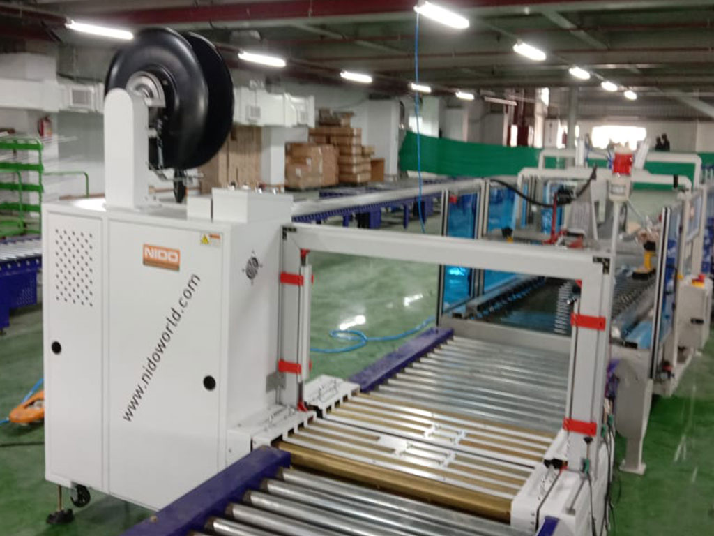 Nido Automatic Online Box Strapping Machine